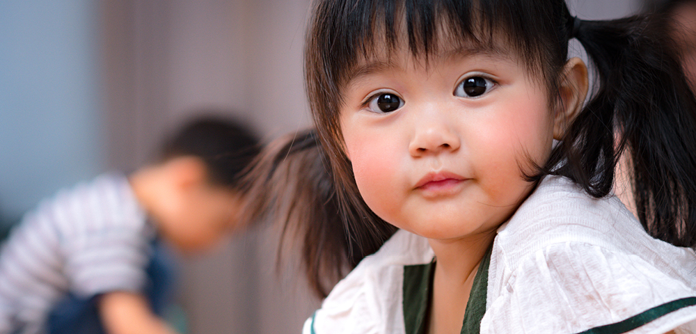 Child Looking Into Camera