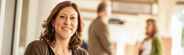Banner image of a woman smiling at the camera